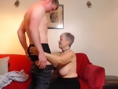 busty granny treats horny jock to a blowjob