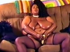Enormous black chick enjoys masturbating with dildo