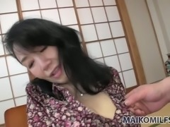 Japanese mature hottie Tsuyako Miyataka flashes her tits in cute bra
