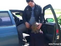 An amateur gives a deepthroat face fucking blowjob in a car
