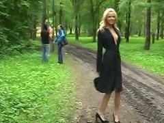Busty and lean Russian blonde teen in the park showing her goodies