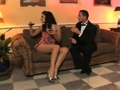 Busty Aletta Ocean uses her feet to make a guy's prick hard