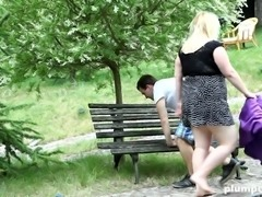 Domme is in the park with her fella and without her clothes