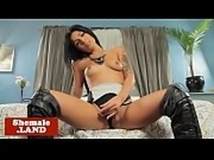 Busty trans babe tugs on her hard prick