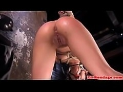 Restrained BDSM beauty fingered in wet pussy