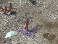 Blonde fine amateur white chick with gorgeous butt on the nudist beach