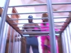 Locked in the cage Asian nympho Kammy sucks big black cock through the bars