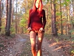 Wonderful Czech redhead Paula Shy stripteases right in the park