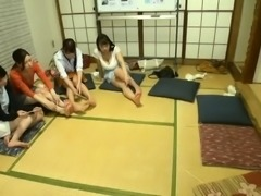 Attractive Japanese girls take turns on a throbbing pole