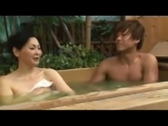 Adorable Japanese lady has a young man fulfilling her needs