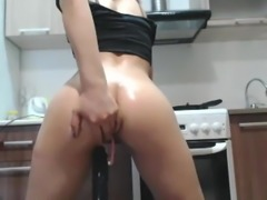 Cam girl rides dildo in kitchen