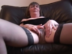 Granny Liz still loves to show off her hairy pussy