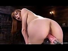 Redhead rides fucking machine and Sybian