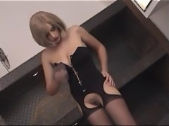 Busty girl in corset strip tease