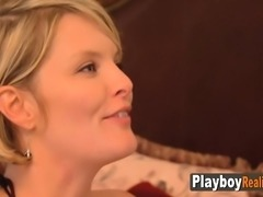 Swinger couples play with sex toys.