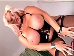 Busty blond in black corset