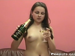 Vera drinks her own pee from a champagne glass