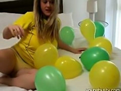 Girl with massive boobies plays with big colored balloons