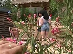 Sexy lesbians touching eachother in their private garden