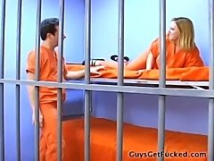 Female guard uses a strapon to fuck male prisoner in the cell, while another female watches and laughs.  Femdom.  Humiliation
