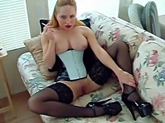 Chick in corset, heels, and stockings smoking