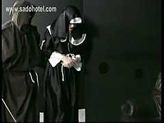 Nun slave praying for mercy is spanked by master priest on her big butt with a wooden stick