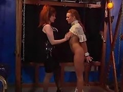 Mistress ties up her naked slave and teases and tortures her